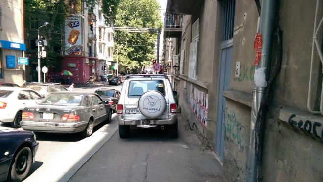 Cars parking on the sidewalk in Tbilisi